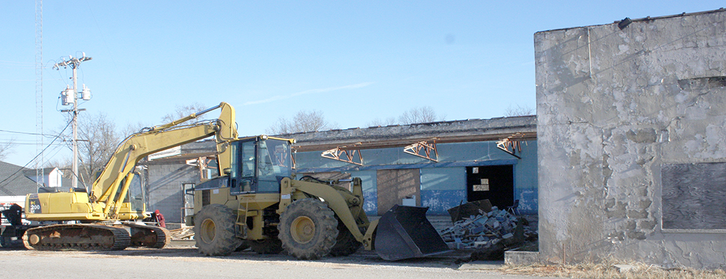 Demolition of the old Holcomb-Porter building has started with the back side of the structure which adjoins the County Board of Education building. Photo by W. Clay Crook/The Lexington Progress.