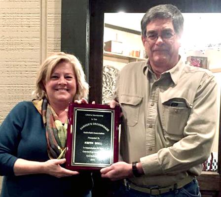 Deborah Teague, left, presents the Lifetime Membership Award to Keith Doll at the Parkers Crossroads Battlefield Association meeting. Photo provided by Deborah Teague.