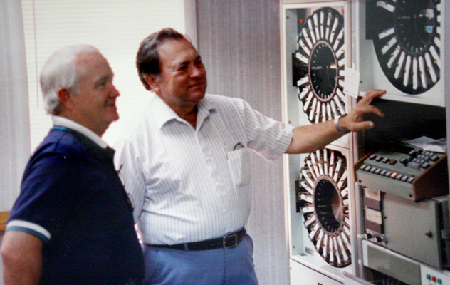 Don Enochs' father, Ben, showing Mayor David Jowers some of the equipment used, before computers, for pre-recorded air time.