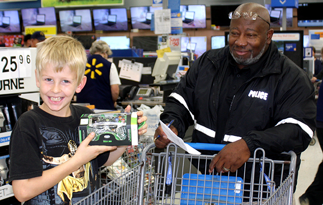 Every smile at Shop With A Cop, Saturday morning, was the winning one. Photo by W. Clay Crook/The Lexington Progress.