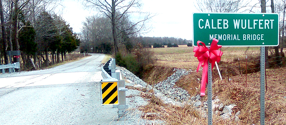 The sign for the Caleb Wulfert Memorial Bridge, which crosses Taylor Creek, on the Juno-Poplar Springs Road. Photo provided by Glenn Kirk.