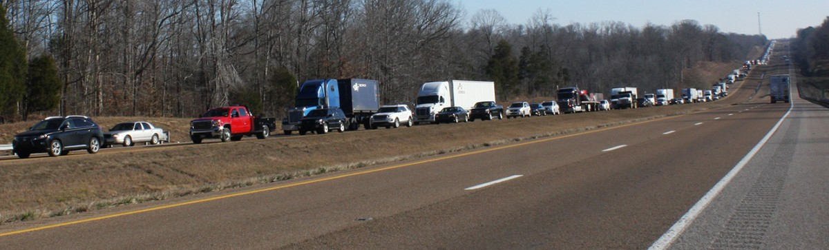 Traffic was blocked in both lanes of the westbound side of Interstate 40 from mile marker 117 to 122 this morning due to a vehicle accident. Photo by W. Clay Crook/The Lexington Progress.