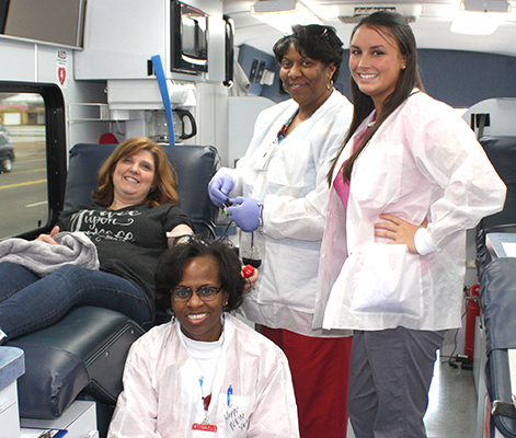 Deanne Pace, left, donates blood at the Walgreen's parking lot. Attending are Lifeline nurses Annette Lewis, Paula Crawford, and Andrea DeMoulin. Photo by W. Clay Crook/The Lexington Progress.