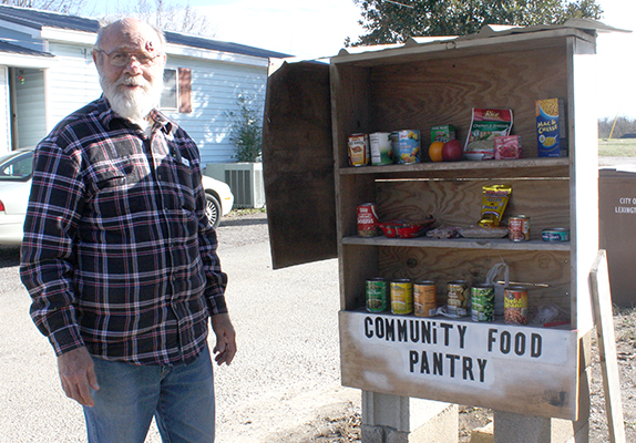David Kimbler stands with the Community Food Shelf on Pine Drive, just off Stanford. Photo by W. Clay Crook/The Lexington Progress.