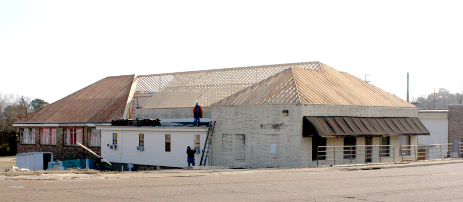 """photo by W. Clay Crook / The Lexington Progress Paramount Plumbing is giving the old Conger Clinic a face-lift and a new roof. The building on East Church Street was erected in 1928 and served as the clinic and hospital of Dr. Robert """"Bob"""" Conger."""