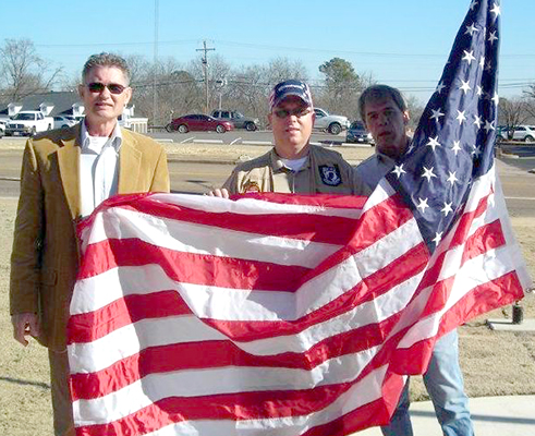 New flags for the courthouse from WoodmanLife. Pictured L to R are: WoodmenLife Representative Jay Rosson, Veterans Affairs Office Director, Eddie Bray and County Maintenance Technician, Steve Pirtle. Photo provided by Gayle Parrish.