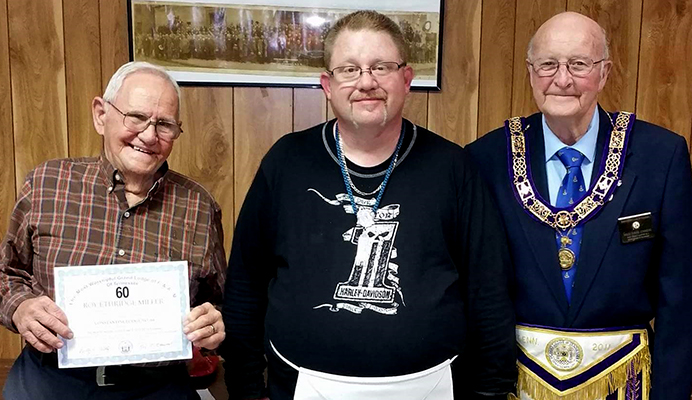 From L-R: Roy Miller, Patrick Richardson, and Past Grand Master Mack E. Johnson. December 29th, Miller received his 60-year membership award and Richardson was raised to the sublime degree of Master Mason. Photo provided by Bobby Blankenship.