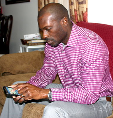 Victor Brown, CEO of Xcellent Life, demonstrates how easily the wellness monitoring application can be accessed through the common cell phone. Photo by W. Clay Crook/The Lexington Progress.