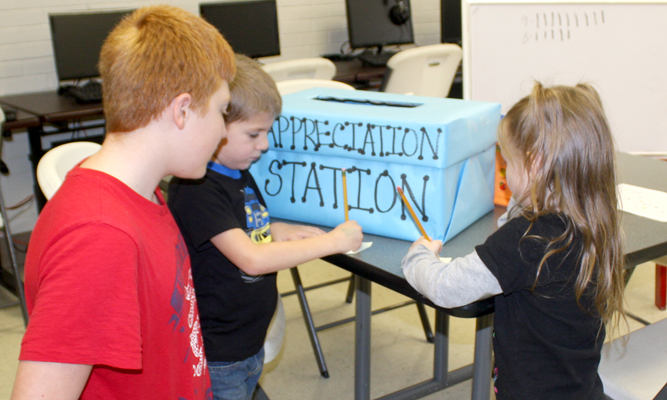 """Photo by W. Clay Crook / The Lexington Progress Westover Elementary students leave encouraging notes in the """"Appreciation Station"""" box during the """"Great Kindness Challenge""""."""