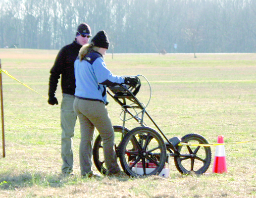Photo by W. Clay Crook / The Lexington Progress Archaeologists, with New South Associates, calibrate the ground penetrating radar device being used to search for battlefield graves at Parkers Crossroads.