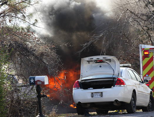 A home on Lakeview Drive South, on the waters of Pine Lake, was engulfed by flames on Friday afternoon. Photo by W. Clay Crook/The Lexington Progress.