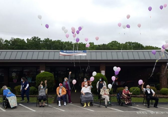 Residents of AHC Lexington participated in a balloon release for National Nursing Home Week. Photo by: W. Clay Crook / The Lexington Progress