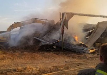 A barn fire on Monday, September 13, 2021 destroyed a combine/harvester and other equipment on Bethel Road. Photo Submitted / The Lexington Progress