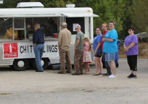 Local citizens gather in around a food truck that was selling chitterling plates on Friday, September 18, 2020. This was a fundraiser for the Matron of Timberlake Grove, as they usually would have sold these at the Henderson County Fair. Photo by: W. Clay Crook / The Lexington Progress